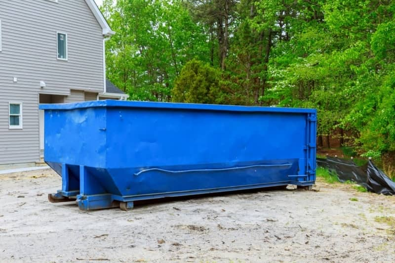 A 20 yard blue dumpster rental at a home remodeling site in the Westwick Augusta GA area.