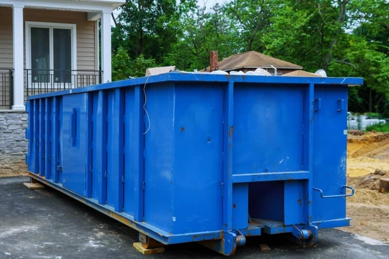 A blue 40 yard construction dumpster at an office in the Tanglewood area in Augusta.