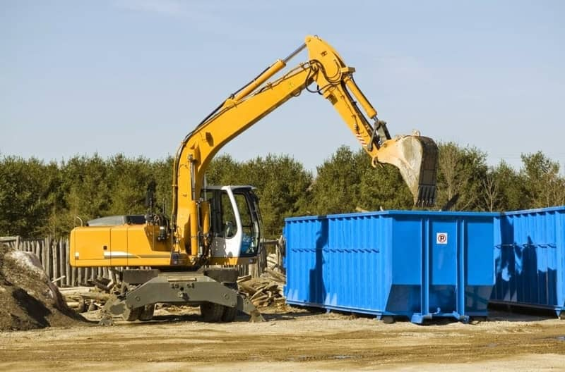 A home construction using a blue dumpster in Roosevelt Dr in Augusta.