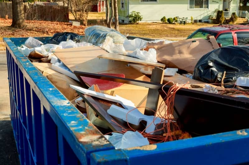 Collected waste in our 20 yard dumpster that is delivered at a driveway of a house near the Columbia Square Shopping Center in Augusta GA area.