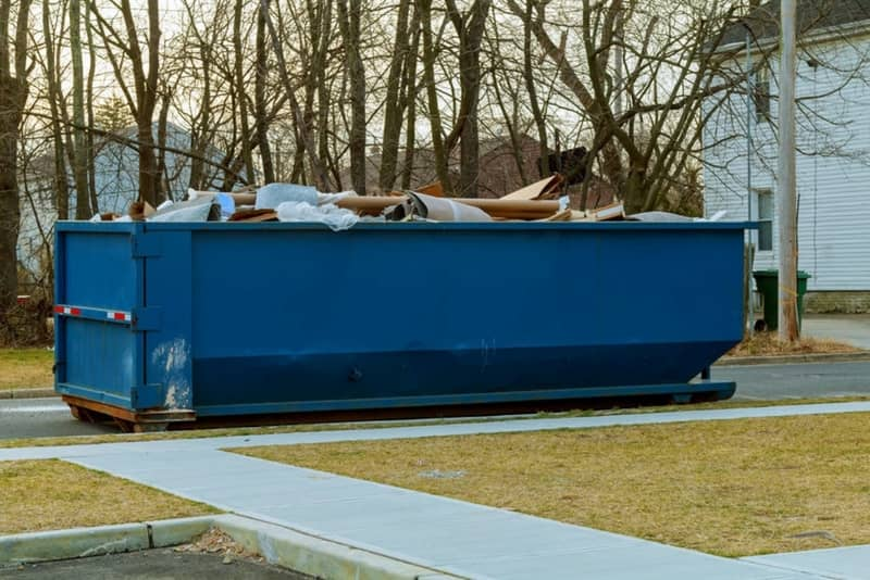 A full 20 yard residential dumpster waiting to get hauled away from the Joiner Crossing Apartments building in Augusta GA area.